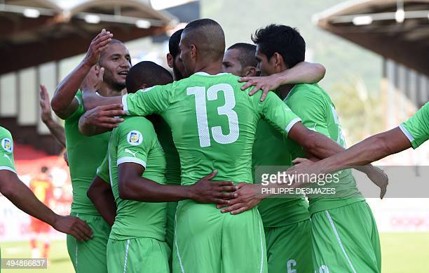 Algeria's forward Islam Slimani is congratulated by teammates after scoring during the friendly football match between Algeria and Armenia at the...