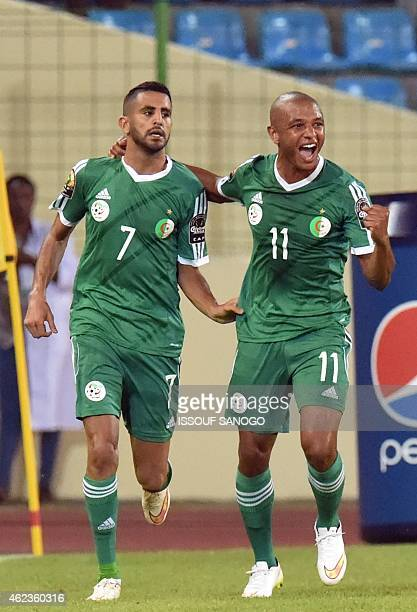 Algeria's forward Riyad Mahrez and Algeria's midfielder Yacine Brahimi celebrate their team's second goal during the 2015 African Cup of Nations...