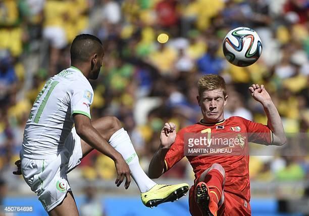 Algeria's forward Riyad Mahrez and Belgium's midfielder Kevin De Bruyne vie for the ball during a Group H football match between Belgium and Algeria...