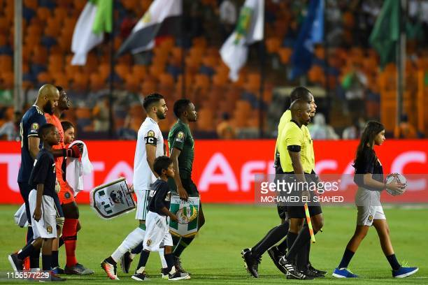 Algeria's forward Riyad Mahrez and Nigeria's forward Ahmed Musa lead their teams onto the pitch during the 2019 Africa Cup of Nations Semi-final...