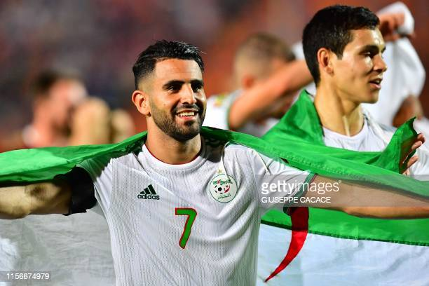 Algeria's forward Riyad Mahrez celebrates after winning the 2019 Africa Cup of Nations Final football match between Senegal and Algeria at the Cairo...