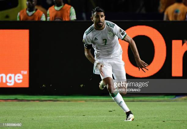 Algeria's forward Riyad Mahrez celebrates his winning goal during the 2019 Africa Cup of Nations Semi-final football match between Algeria and...