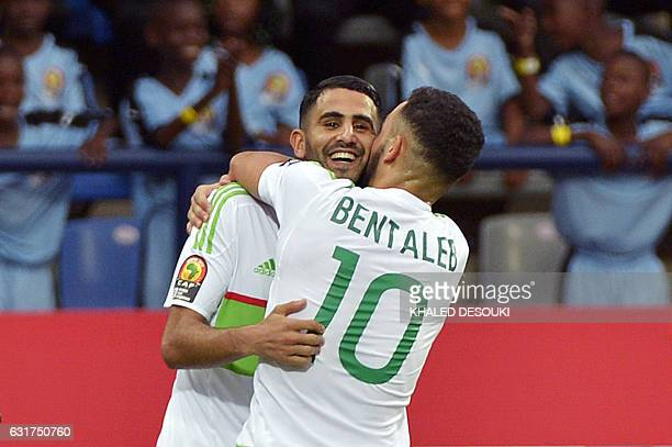 Algeria's forward Riyad Mahrez celebrates with Algeria's midfielder Nabil Bentaleb after scoring a goal during the 2017 Africa Cup of Nations group B...