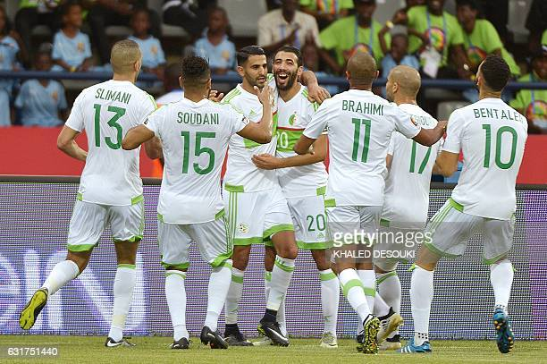 Algeria's forward Riyad Mahrez celebrates with teammates after scoring a goal during the 2017 Africa Cup of Nations group B football match between...