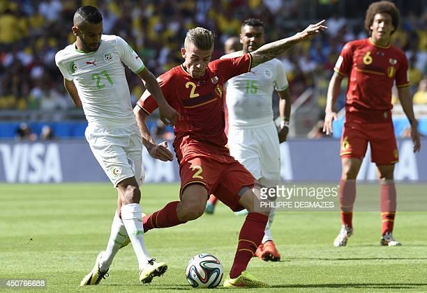 Algeria's forward Riyad Mahrez challenges Belgium's defender Toby Alderweireld during the Group H football match between Belgium and Algeria at the...
