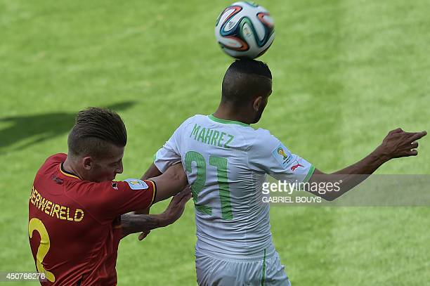 Algeria's forward Riyad Mahrez is challenged by Belgium's defender Toby Alderweireld during the Group H football match between Belgium and Algeria at...