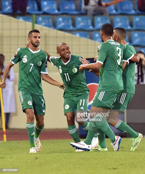 Algeria's forward Riyad Mahrez is congratulated by teammates after scoring a goal during the 2015 African Cup of Nations group C football match...