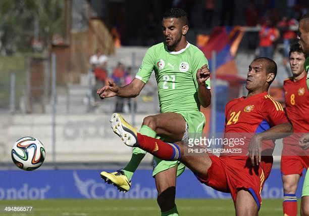 Algeria's forward Riyad Mahrez Riyad Mahrez vies for the ball with Armenian defender Alex Da Silva during the friendly football match between Algeria...