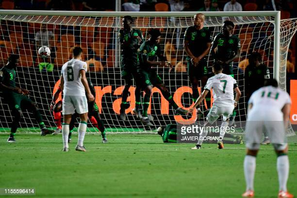 Algeria's forward Riyad Mahrez scores from a free-kick during the 2019 Africa Cup of Nations Semi-final football match between Algeria and Nigeria at...
