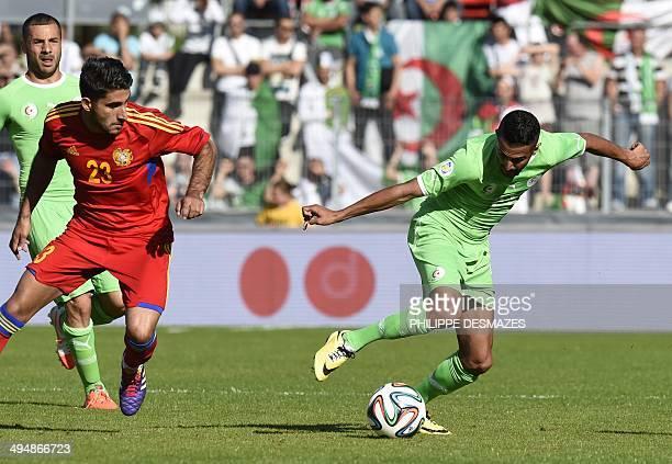Algeria's forward Riyad Mahrez vies for the ball with Armenian midfielder Aras Ozbiliz during the friendly football match between Algeria and Armenia...