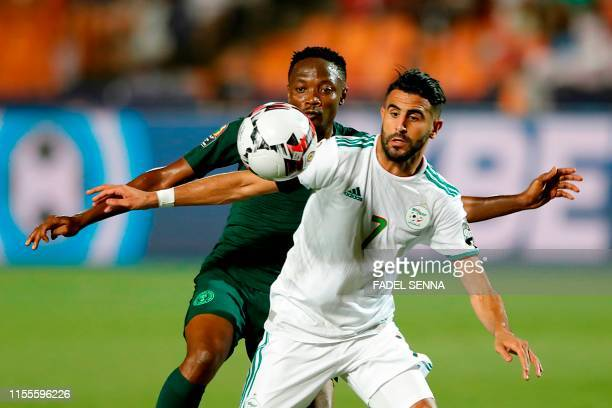 Algeria's forward Riyad Mahrez vies for the ball with Nigeria's forward Ahmed Musa during the 2019 Africa Cup of Nations Semi-final football match...