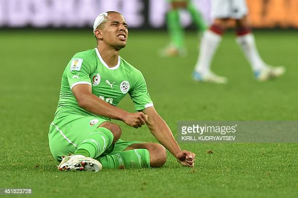 Algeria's forward Sofiane Feghouli after losing their Round of 16 football match against Germany following extratime at BeiraRio Stadium in Porto...