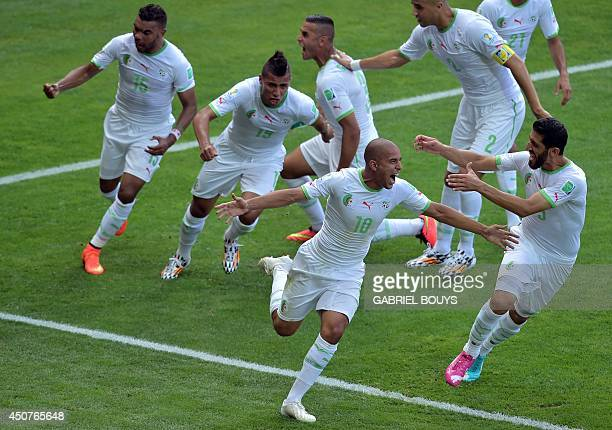 Algeria's forward Sofiane Feghouli celebrates after scoring his team's first goal during the Group H football match between Belgium and Algeria at...