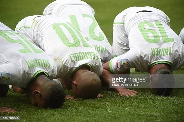 Algeria's forward Sofiane Feghouli celebrates with his teammates after scoring a penalty during a Group H football match between Belgium and Algeria...