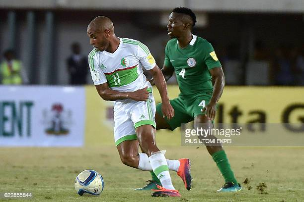 Algeria's forward Yacine Brahimi challenges Nigeria's defender Kenneth Omeruo during the 2018 FIFA World Cup African zone group B qualifying football...