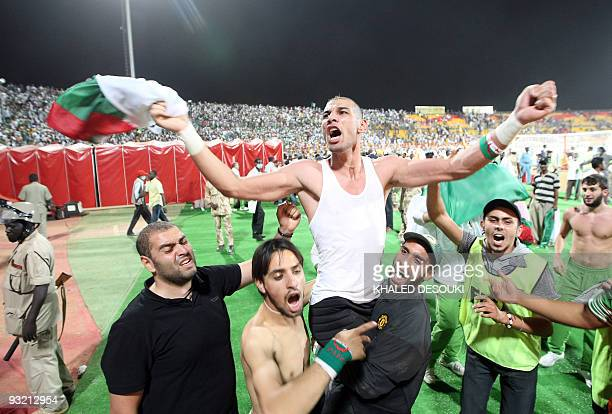Algeria's goalkeeper Faouzi Chaouchi celebrates after winning the 2010 World Cup qualifying playoff football match against Egypt in Khartoum on...