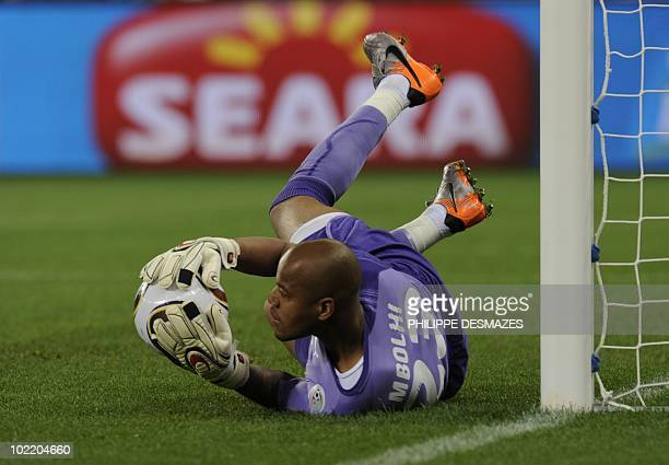 Algeria's goalkeeper M'bohi Rais Ouheb makes a save during the Group C first round 2010 World Cup football match England vs Algeria on June 18 2010...