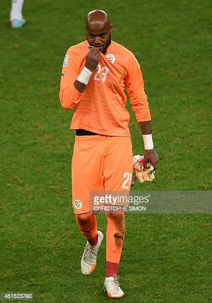 Algeria's goalkeeper Rais Mbohli reacts after the Round of 16 football match between Germany and Algeria at BeiraRio Stadium in Porto Alegre during...