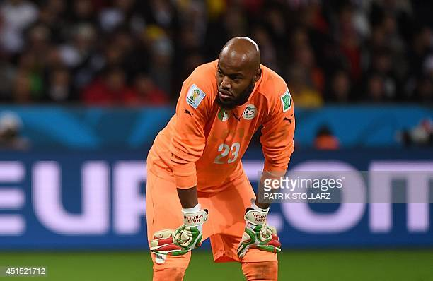 Algeria's goalkeeper Rais Mbohli reacts during a Round of 16 football match between Germany and Algeria at BeiraRio Stadium in Porto Alegre during...