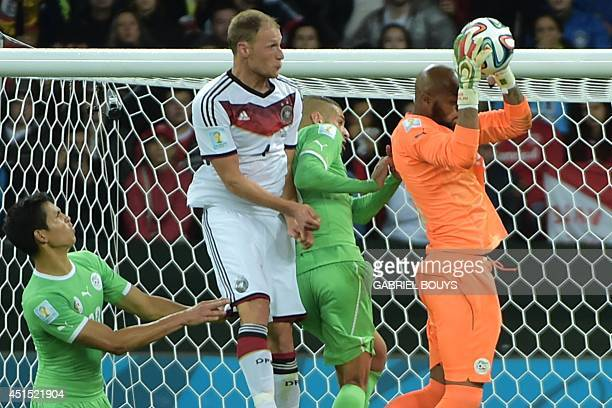 Algeria's goalkeeper Rais Mbohli saves the ball during the Round of 16 football match between Germany and Algeria at BeiraRio Stadium in Porto Alegre...
