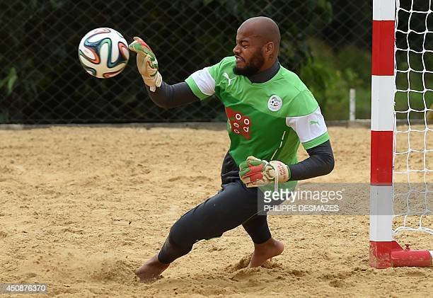 Algeria's goalkeeper Rais Mbohli stops a ball during a training session at the Atletico World Sports Center in Sorocaba on June 19 2014 as part of...
