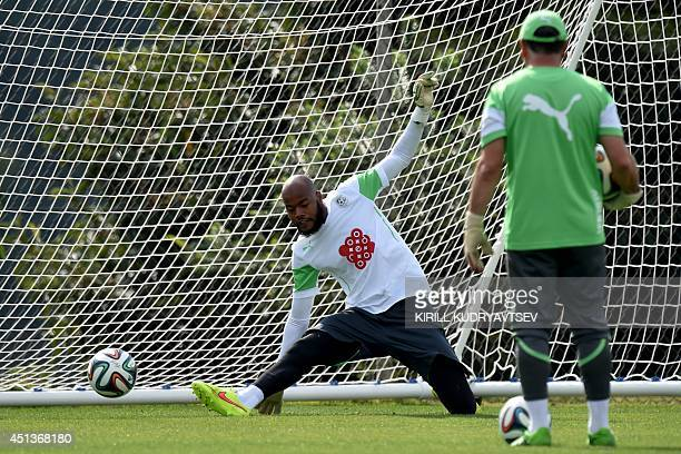 Algeria's goalkeeper Rais Mbohli takes part in a training session on June 28 2014 in Sorocaba during the 2014 FIFA World Cup football tournament AFP...