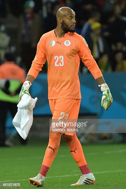 Algeria's goalkeeper Rais Mbohli walks on the pitch for the first half of extratime in the Round of 16 football match between Germany and Algeria at...