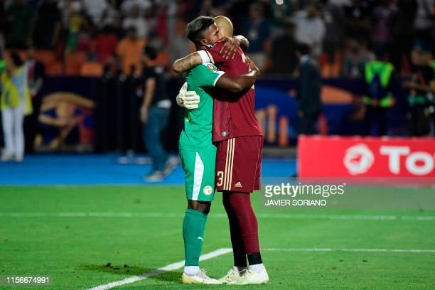 TOPSHOT Algeria's goalkeeper Rais M'Bolhi is greeted by Senegal's forward Keita Balde following the 2019 Africa Cup of Nations Final football match...
