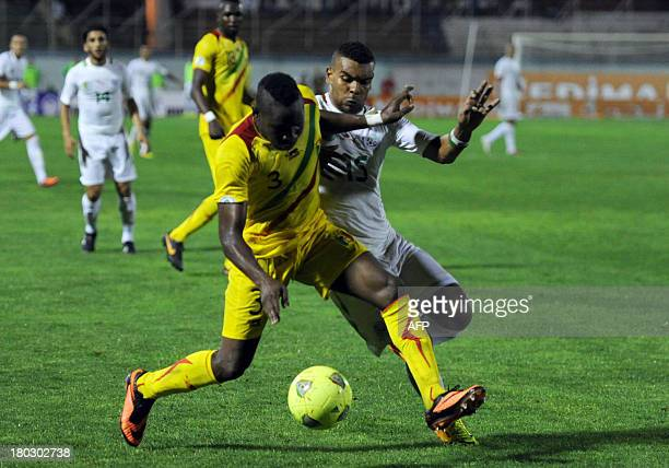 Algeria's Hilal Soudani challenges Mali's Adama Tamboura for the ball during their World Cup 2014 Group H qualifier football match at the Mustapha...