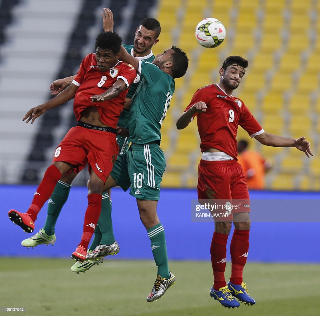 Algeria's Ibrahim Chenihi (C), Nabil Bentaleb (C-back) compete for the ball against Oman's Raed Ibrahim (L) and Abdul Aziz Al-Maqbil (R) during their friendly football match on March 30, 2015 at the Qatar Club Stadium in Doha, as part of the preparations for the second round of the 2018 World Cup's Asian leg qualifiers.