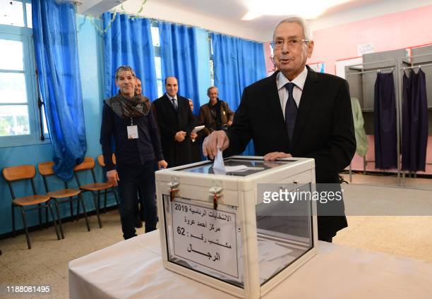 Algeria's interim president Abdelkader Bensalah casts his vote during the presidential election on December 12 2019 at a polling station in Algiers...