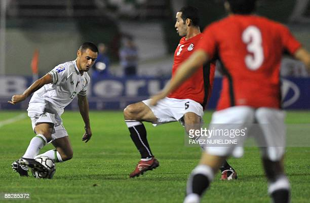 Algeria's Karim Ziani attempts to dribble as Egypt's Mohammed Aboutrika defends during their 2010 World Cup African zone Group C qualifying football...