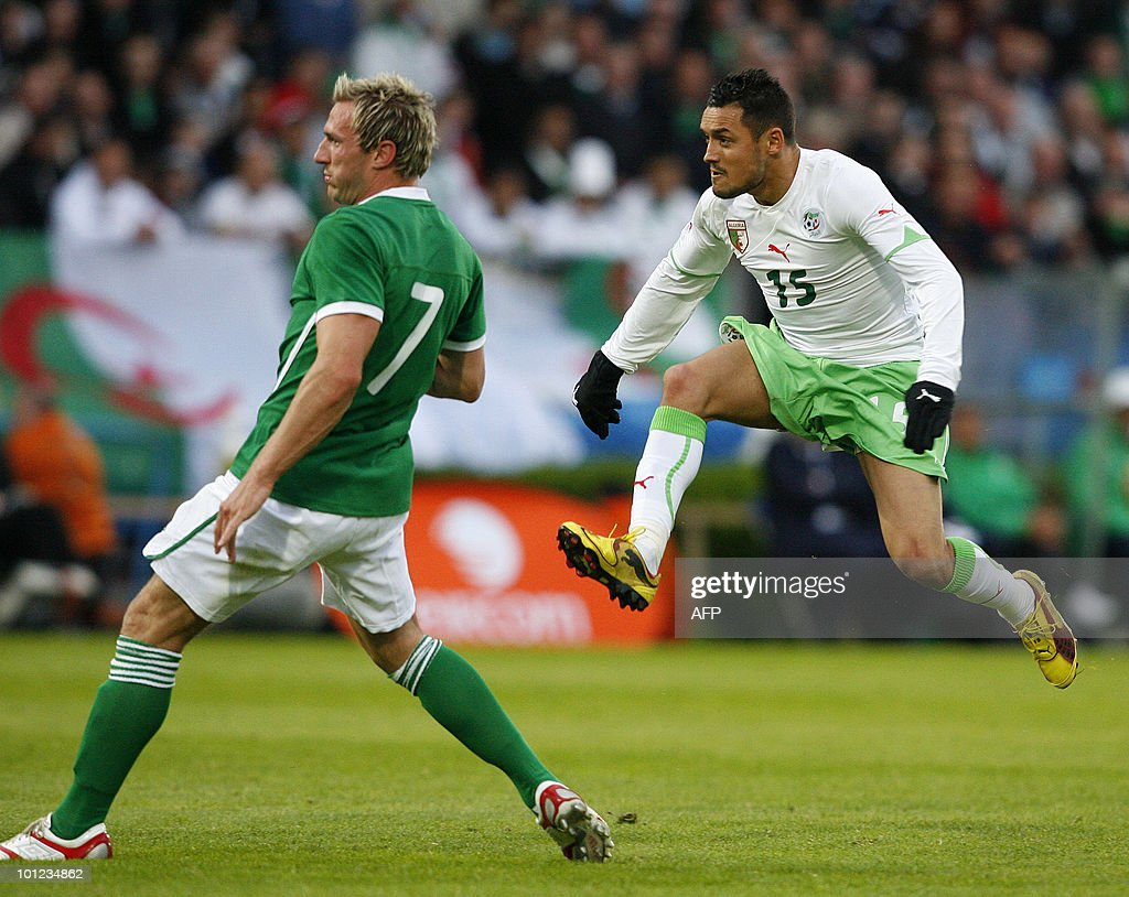 Algeria's Karim Ziani (R) takes a shot on goal as Ireland's Liam Lawrence (L) looks on during a international friendly match at the RDS Arena in Dublin, Ireland May 28, 2010.World Cup-bound Algeria looked toothless in attack and shaky in defence as they suffered a tame 3-0 defeat to Ireland in a World Cup friendly. AFP PHOTO/Peter Muhly
