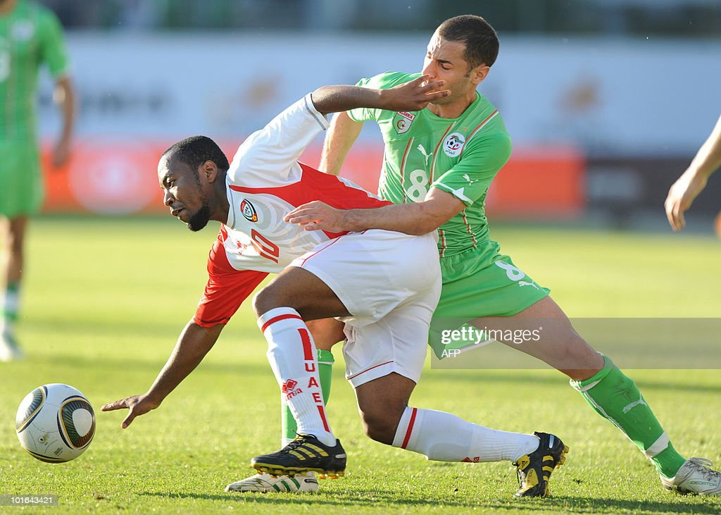 Algeria's Lacen Medhi (R) and Emirates Ahmed Khalil (L) challenge for the ball during a friendly football match between Algeria and the United Arab Emirates in Fuerth, southern Germany, June 5, 2010.
