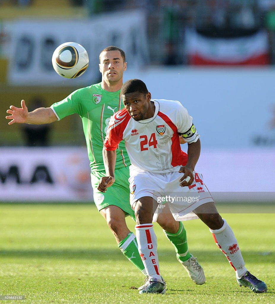 Algeria's Lacen Medhi (L) and Emirates Subait Khater Al Jenaibi (R) challenge for the ball during a friendly football match between Algeria and the United Arab Emirates in Fuerth, southern Germany, June 5, 2010.