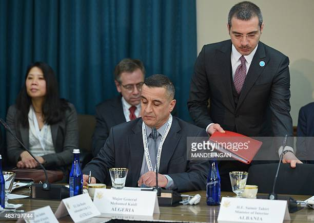 Algeria's Major General Mohamed Kaidi and Albania's Minister of Interior Saimir Tahiri take their seats for the White House Summit on Countering...