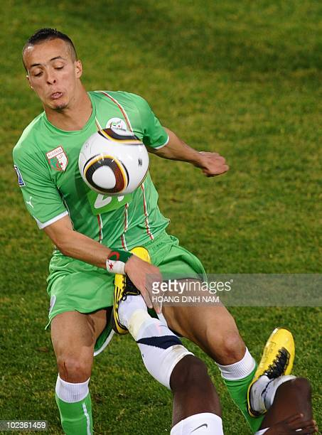 Algeria's midfielder Fouad Kadir eyes the ball as the foot of US striker Jozy Altidore land in his crotch during their Group C first round 2010 World...