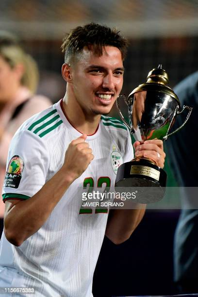 Algeria's midfielder Ismail Bennacer celebrates the trophy of Best Young Player of the Tournament following the 2019 Africa Cup of Nations Final...