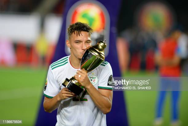 TOPSHOT Algeria's midfielder Ismail Bennacer celebrates the trophy of best young player after winning the 2019 Africa Cup of Nations Final football...