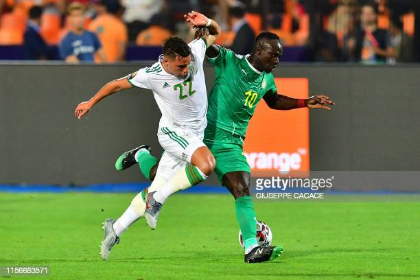 Algeria's midfielder Ismail Bennacer fights for the ball with Senegal's forward Sadio Mane during the 2019 Africa Cup of Nations Final football match...