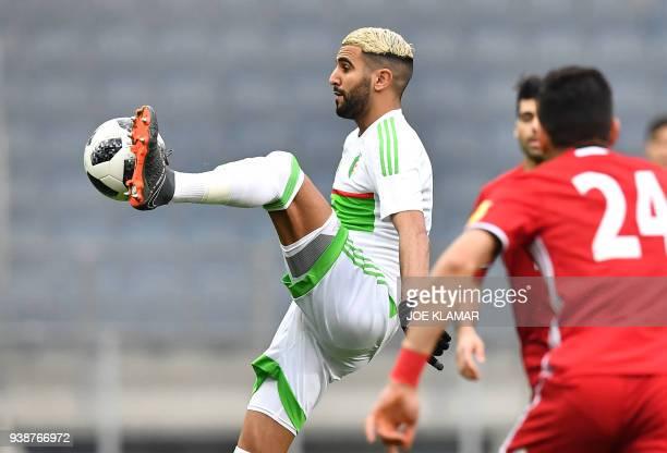 Algeria's midfielder Riyad Mahrez plays a ball during the international friendly football match between Iran and Algeria at the Merkur Arena in Graz...