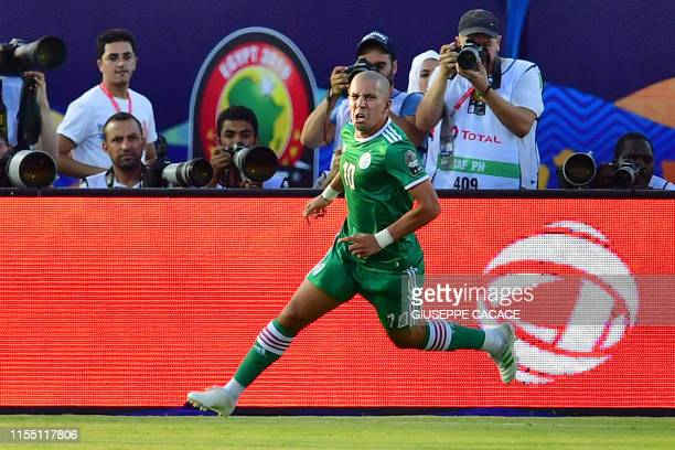Algeria's midfielder Sofiane Feghouli celebrates after scoring a goal during the 2019 Africa Cup of Nations quarter final football match between...