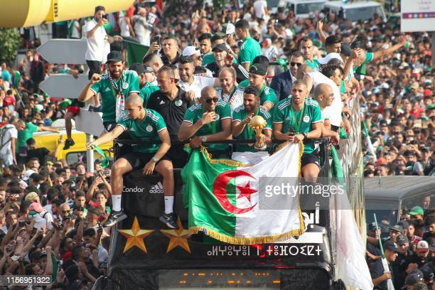 TOPSHOT Algeria's midfielder Sofiane Feghouli goalkeeper Izzeddine Doukha midfielder Riyad Mahrez and forward Islam Slimani greet their fans during...