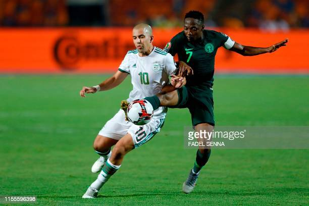 Algeria's midfielder Sofiane Feghouli is marked by Nigeria's forward Ahmed Musa during the 2019 Africa Cup of Nations Semi-final football match...