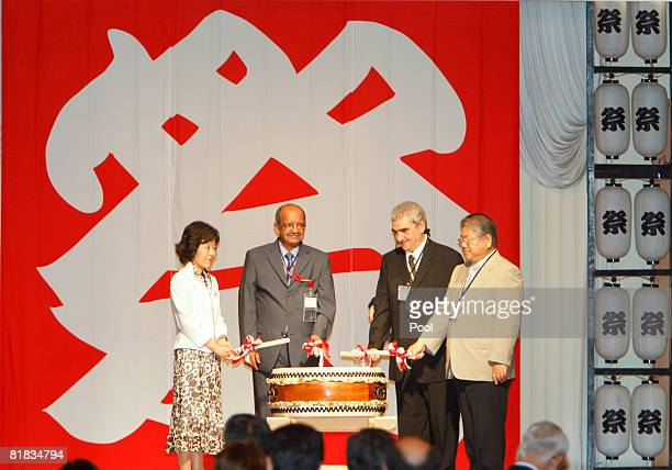 Algeria's Minister of State for Maghreb and African Affairs Abdelkader Messahel and Algeria's ambassador to Japan Sid Ali Ketrandji pose on the stage...