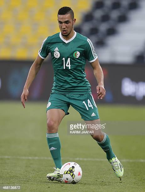 Algeria's Nabil Bentaleb dribbles the ball during their friendly football game against Oman on March 30 2015 at the Qatar Club Stadium in Doha as...