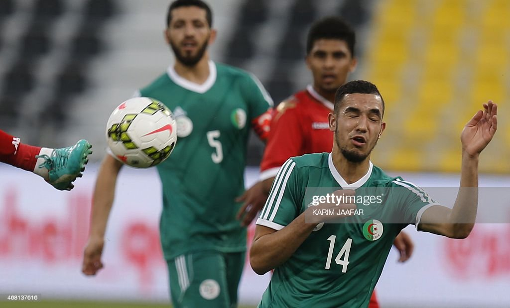 Algeria's Nabil Bentaleb reacts after heading the ball during their friendly football match against Oman on March 30, 2015 at the Qatar Club Stadium in Doha, as part of the preparations for the second round of the 2018 World Cup's Asian leg qualifiers.