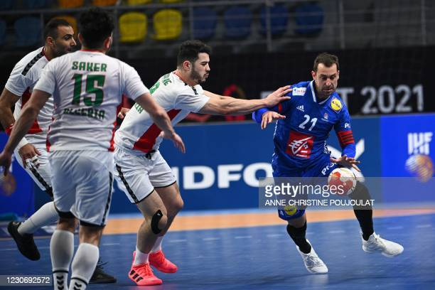 Algeria's pivot Hichem Kaabeche challenges France's wing Michael Guigou during the 2021 World Men's Handball Championship between Group III teams...
