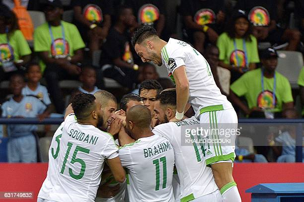 Algeria's players celebrate after scoring a goal during the 2017 Africa Cup of Nations group B football match between Algeria and Zimbabwe in...