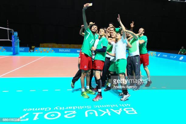 Algeria's players celebrate as they win bronze medal after the match between Algeria and Turkey on day ten of the Baku 2017 4th Islamic Solidarity...